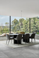 Elegant dining area with panoramic glass walls