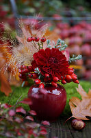 Posy of dahlias and rose hips