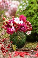 Autumn bouquet in green glass vase