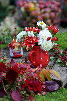 Dahlias and snowberries in jug