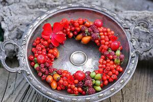 Wreath of berries in vintage dish