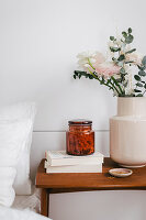 DIY room fragrance with stone pine shavings in jar on bedside table