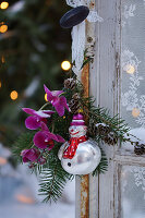 Posy and clown snowman hung on door handle as Christmas tree decorations