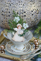 Nostalgic Christmas angel in a collector's cup
