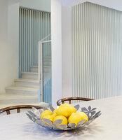 Lemons in silver designer bowl