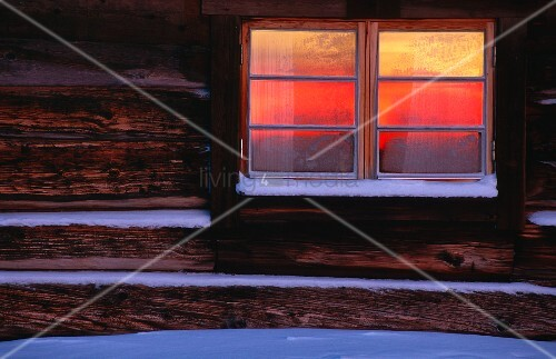 A cabin window in the snow