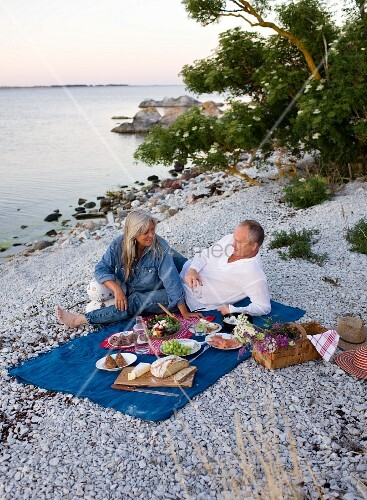 A couple having a picnic on a beach