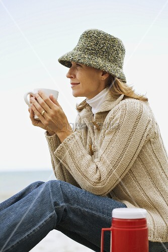 Woman having a hot drink
