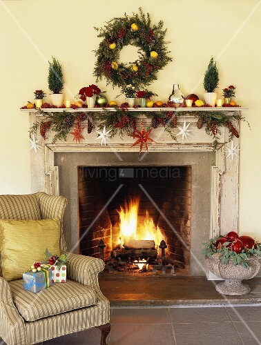 Open fireplace with Christmas decorations in living room