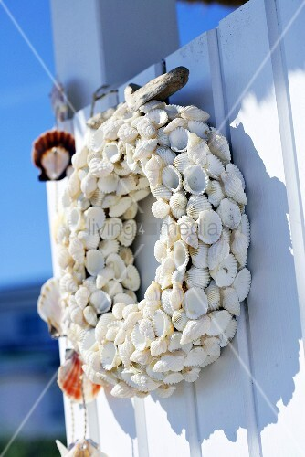 Wreath of shells on a wooden wall
