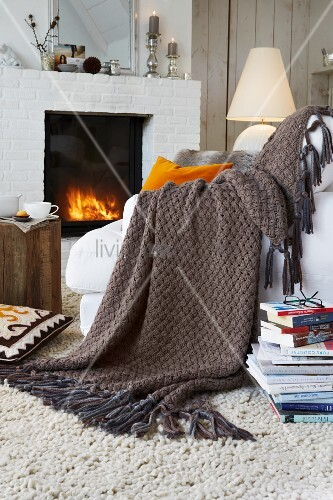 A knitted woollen throw with a criss-cross pattern