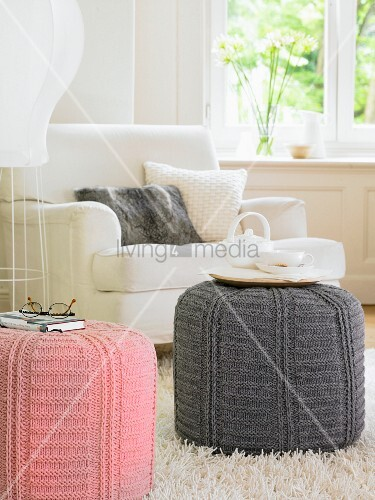Two pouffees with pink and grey crocheted covers