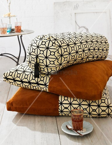 Oriental-style cushions & bolster