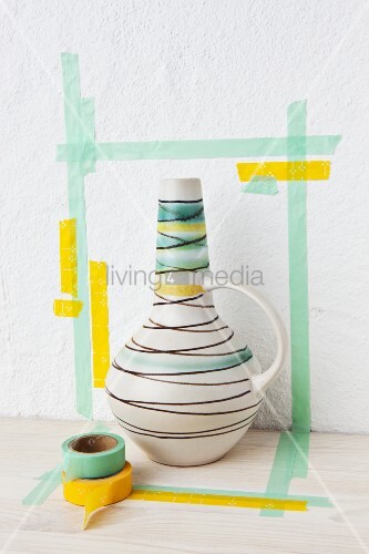 A 1950s-style vase in a masking tape frame