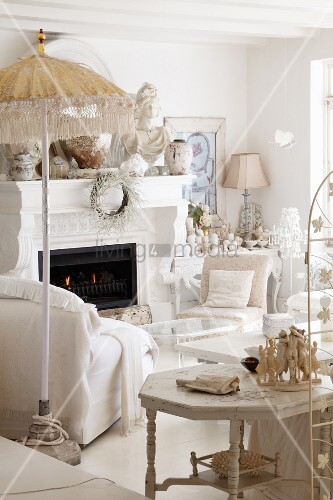 White living room with fireplace and collection of sculptures