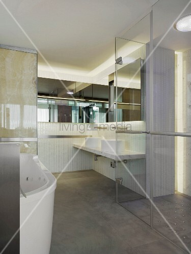Bathroom with glass walls and door in modern home