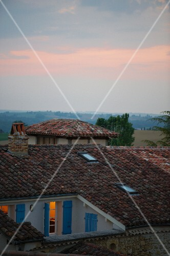 Sunset view across roofs of a small French village in the Gers region