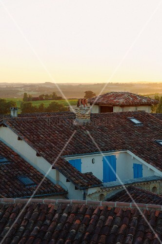 View of horizon across roofs of small French village