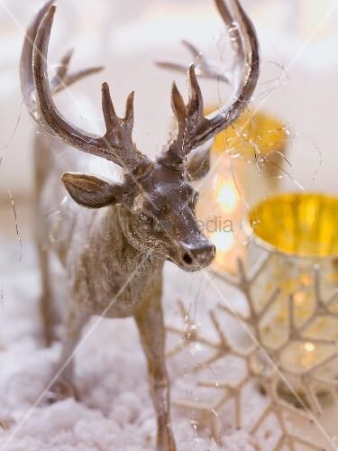 Christmas arrangement with reindeer ornament