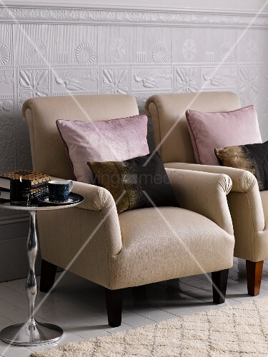 Upholstered chairs and side tables in living room