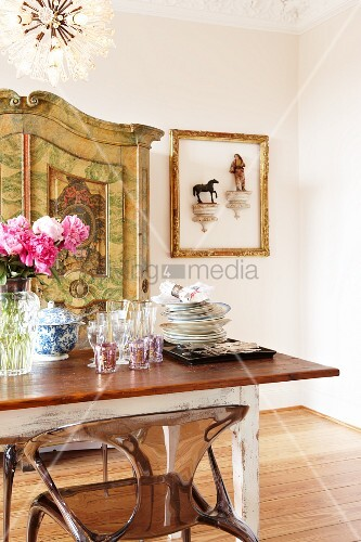 Dining room with plexiglass chairs and objet d'art on wall