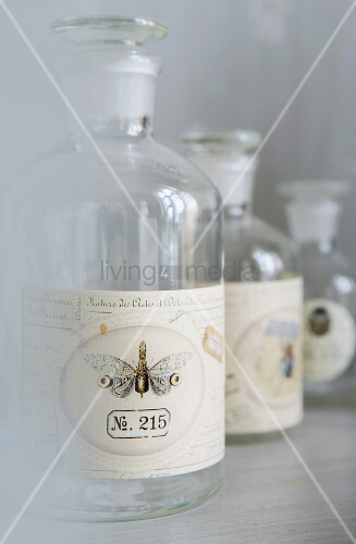 Empty apothecary's bottles with labels