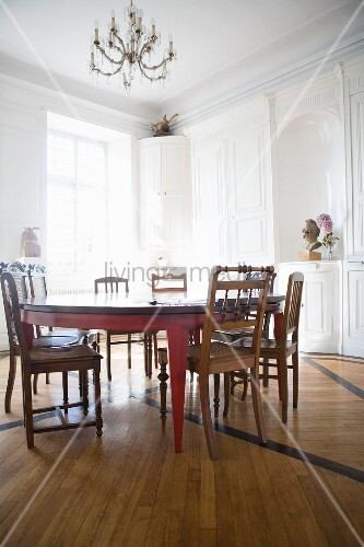 White dining room with a handmade table in a former monastery