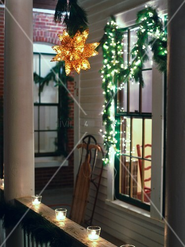 New England porch decorated for christmas