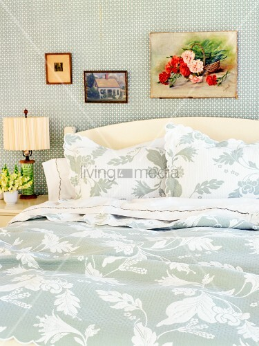 Bed with floral patterened blankets and pillows