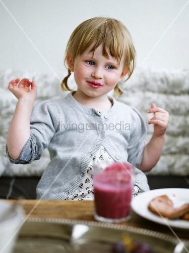 A girl eating, Sweden.