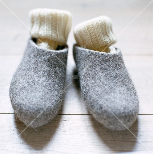 A pair of slippers with woolen socks