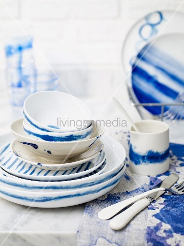 Blue and white crockery (plates, cups, bowls) and cutlery