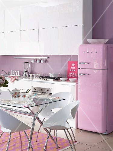 White Kitchen With Lilac Wall And Pink Retro Fridge