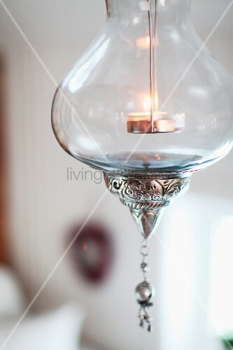 Suspended glass candle lantern with silver ornamentation