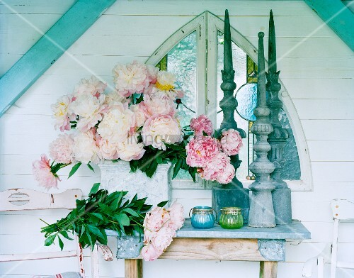 Peonies on altar table in shrine