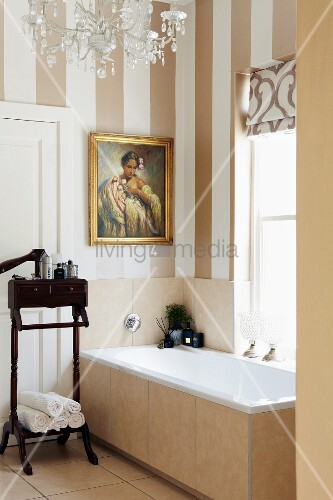 Superieur Antique, Dark Wood Valet Stand Next To Bathtub Below Window In Bathroom  With Striped Wallpaper