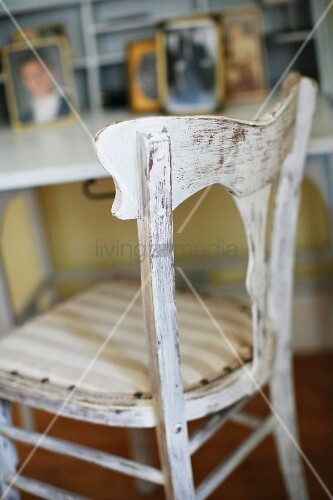Vintage kitchen chair with white peeling paint