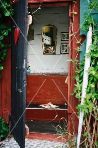 View into privy in wooden hut