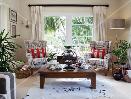 Two wing-back chairs and wooden coffee table in exotic living room