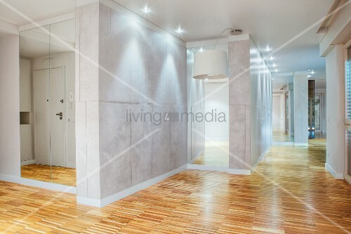 Empty showcase interior with parquet flooring and recessed lights