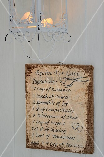 Vintage-style 'Recipe for love' painted on hessian below romantic wire-framed candle lantern