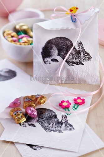 Bags for Easter treats decorated with rabbit motifs and held closed with decorative paper clips