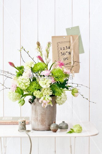 Large bouquet of chrysanthemums, viburnum, parrot tulips, birch twigs, nerine lilies and tuberose flowers