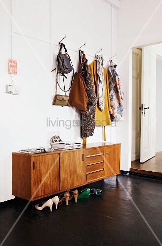 Coat rack above 50s sideboard in foyer of loft apartment
