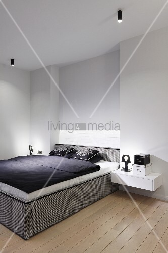 Minimalist bedroom with box-spring bed … – Buy image ...