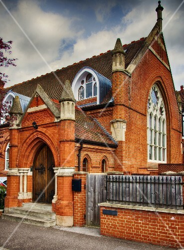 Renovated Neogothic church with brick facade