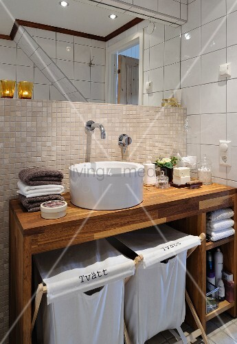 Custom washstand made from exotic wood with folding canvas laundry baskets