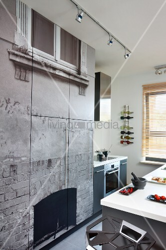 Fitted kitchen cupboards with photo mural on fronts