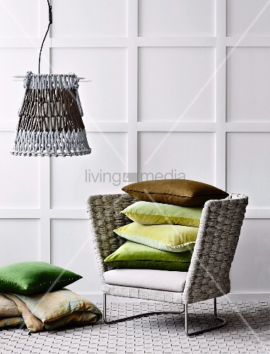 Armchair with woven backrest, carpet made from interlaced strips and crochet-style lampshade