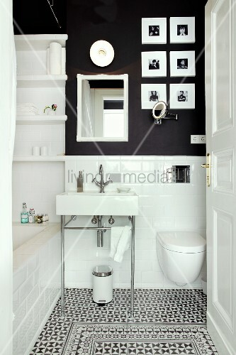 Small bathroom with subway tiles, charcoal wall and decorative floor tiles